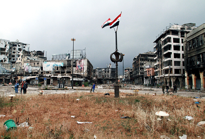 Syrian national flags seen in Homs