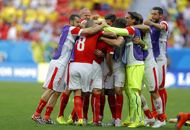 The Swiss team celebrate their win over Ecuador