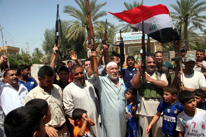 Iraqi volunteers call to fight the militants