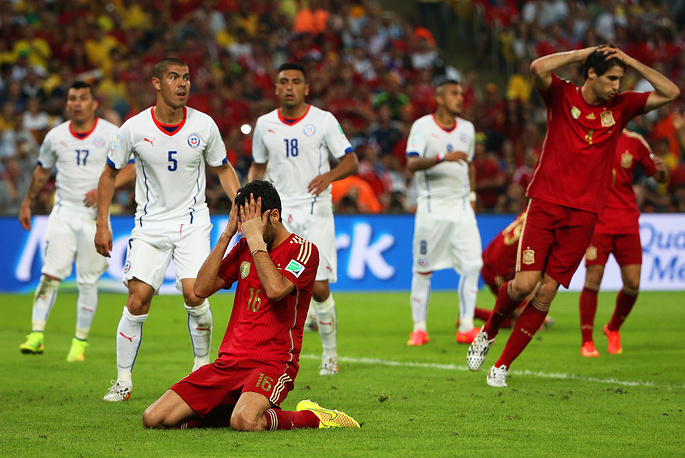 Spain's Sergio Busquets (bottom) reacts after missing a chance