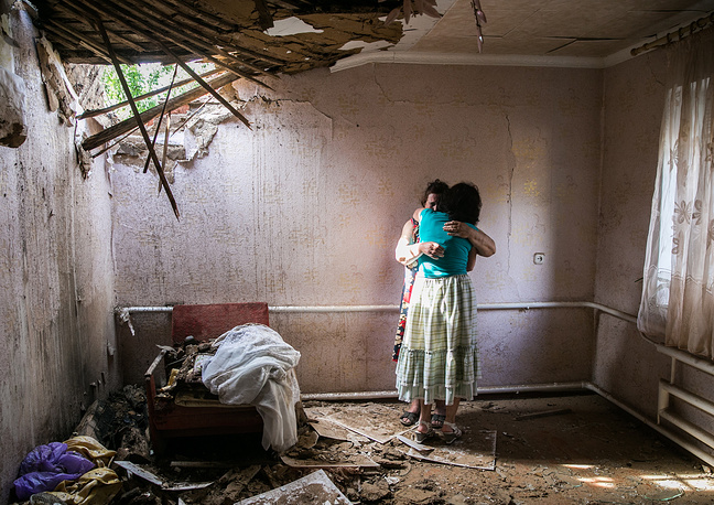 People in their house destroyed in a shelling attack in east Ukraine's Sloviansk