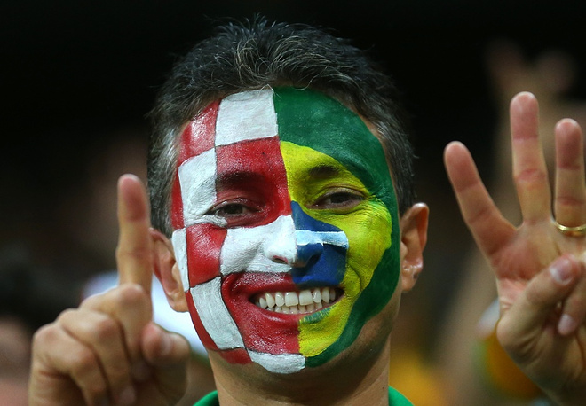 A fan at the opening match of the World Cup between Croatia and Brazil decided to support both teams