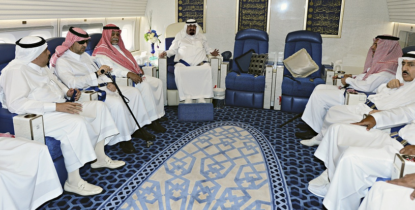 King Abdullah of Saudi Arabia (center) in a meeting on board his private jet (2011)
