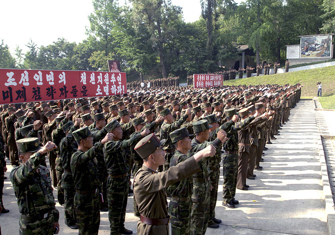 North Korean soldiers hold a ceremony to mark the Korean War anniversary on June 25