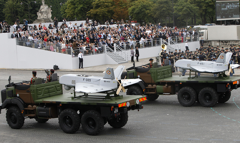 Drones are displayed on military trucks