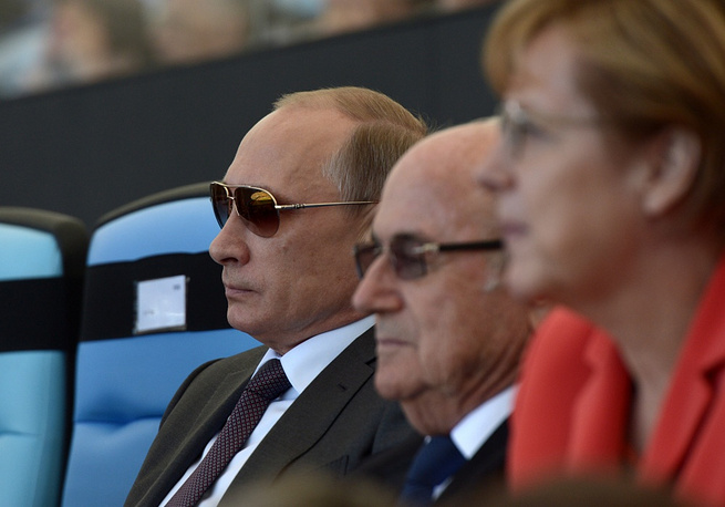 Vladimir Putin, Sepp Blatter and Angela Merkel watch the World Cup final