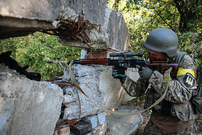 A sniper takes aim during a battle against militia not far from Donetsk