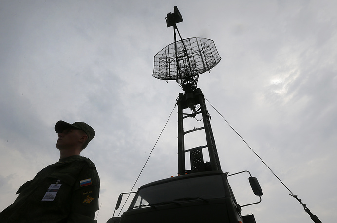 A Russian soldier stands guard near Russia's military system of location Kasta 2,2