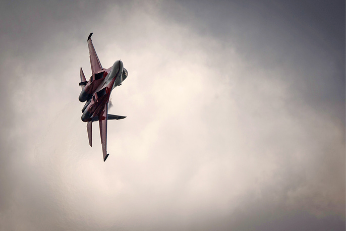 A Sukhoi Su-30 fighter performs during the Forsazh (Boost) car and air show