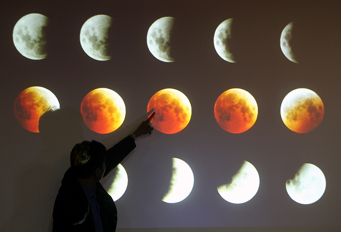 Phases of a total lunar eclipse on the monitor during a press conference in Jakarta, Indonesia, on 08 October 2014