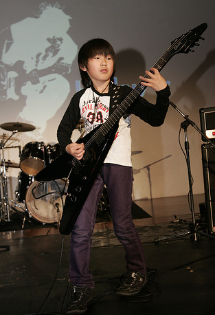 Yuto Miyazawa from Japan became world's youngest professional guitarist at the age of 10. He made it into the 'Guinness Book Of World Records', performing during a concert in Hong Kong, China, 17 April 2010