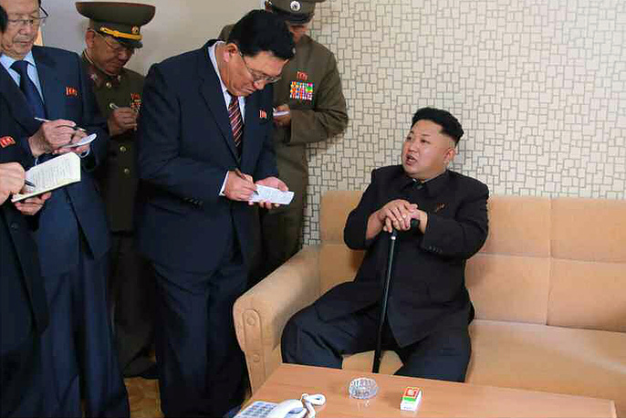 North Korean leader Kim Jong-un appeared in the country's official media on Tuesday, October 14 for the first time in 40 days, with several photos of him using a cane for support.  A photo released by the Rodong Sinmun, the newspaper of North Korea's ruling Workers Party, on 14 October 2014, shows North Korean leader Kim Jong-un (R) speaking during his visit to the Wisong Scientists Residential District in Pyongyang, North Korea, 13 October 2014