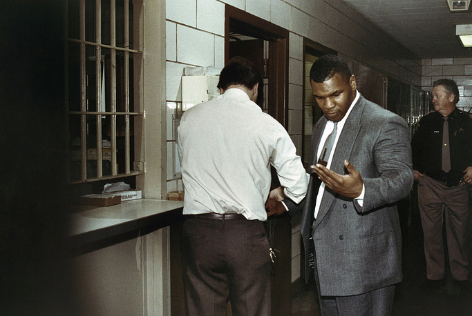 In 1992, famous boxer Mike Tyson was convicted of raping  and sentenced to six years in prison but was released after serving three years. Later in 1997 he was involved in a scandal with Evander Holyfield as he bited a piece of Holyfield's ear during a fight. Photo: Mike Tyson after receiving a sentence of six years in prison, Indianapolis, USA, March 26, 1992