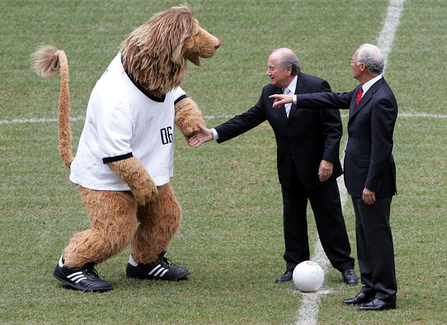 """Photo: The president of the organizing committee of 2006 World Cup, Franz Beckenbauer and FIFA President Joseph Blatter prepare for a symbolic kick off with World Cup mascot """"Goleo"""" at the Allianz Arena stadium in Munich, Germany"""