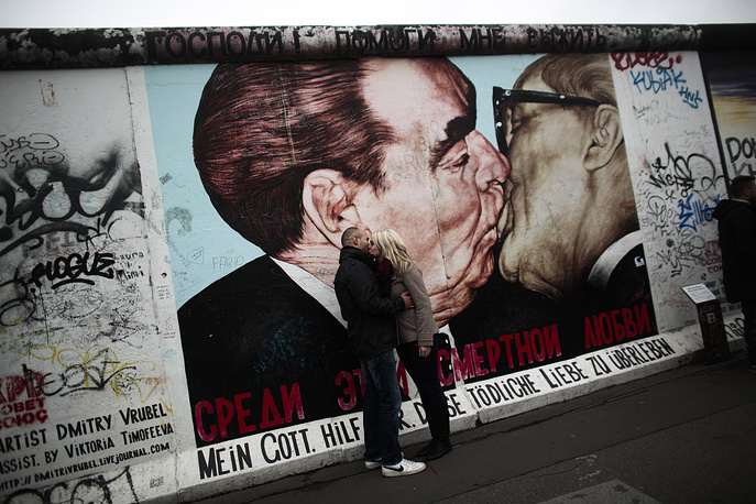 Photo: A painting of former Soviet leader Leonid Brezhnev, left, and long time East German communistic leader Erich Honecker at the East Side Gallery in Berlin
