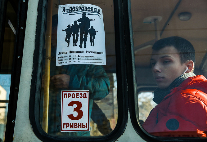 Ukrainian President Petro Poroshenko announced Kiev's readiness to enact a new law on Donbass special status which would draw clear-cut borders of districts with special local self-rule status. Photo: Tram in Donetsk with a sign promoting recruitment to the army of the Donetsk People's Republic