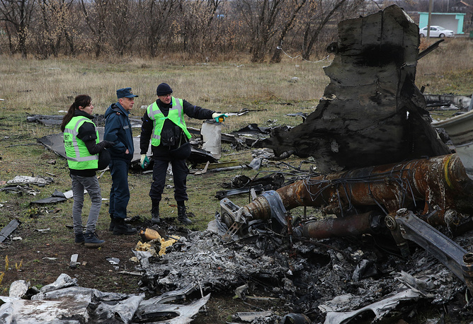 Photo: Fragments of the Malaysia Airlines passenger flight MH17 are being loaded onto trucks to be sent to the Netherlands for investigation, November 16 2014