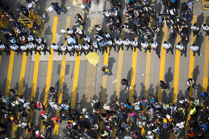 Group of demonstrators face lines of police at the intersection of Dundas Street and a cleared Nathan Road in Hong Kong