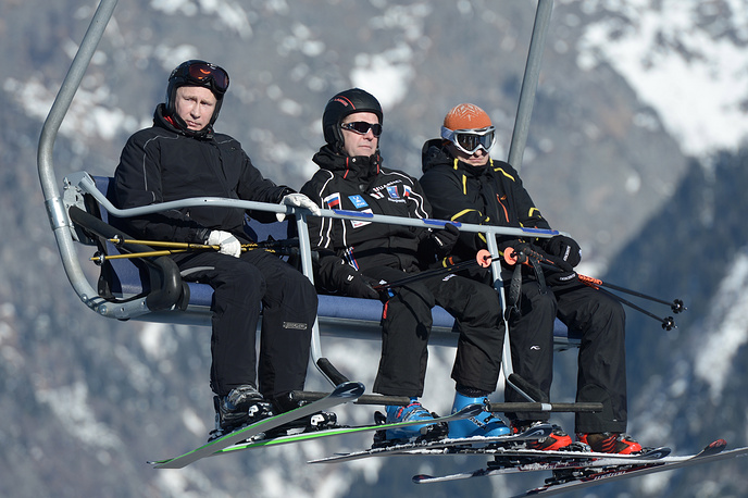 Russian President Vladimir Putin and Prime Minister Dmitry Medvedev take a chairlift ride at the Laura Biathlon and Ski Complex near Sochi