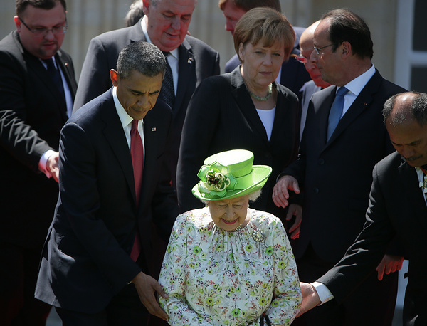 US President Barack Obama, Queen Elizabeth II, German Chancellor Angela Merkel and French President Francois Hollande before the ceremony marking the D-Day 70th anniversary in Normandy