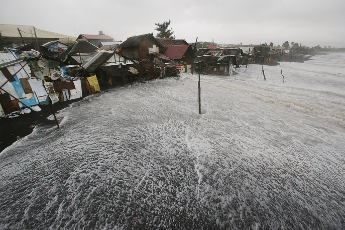 Typhoon knocked out power in entire coastal provinces, mowed down trees and forced more than 1 million people to evacuate. Photo: Strong waves crash into coastal houses as Typhoon Hagupit pounds Legazpi, eastern Philippines