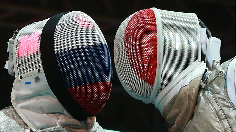 Russia's Dmitry Rigin (left) and Enzo Lefort of France compete in the men's preliminary round individual foil at the 2014 Fencing World Championships, at Basket-Hall Arena in Kazan
