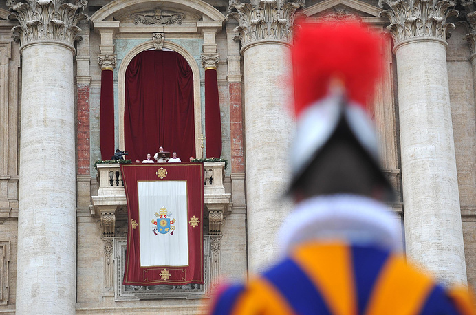 """The Pope traditionally delivers his """"Urbi et Orbi"""" (to the city and to the world) blessing from the central balcony of St. Peter's Basilica at the Vatican on December 25"""