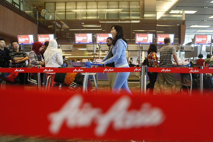 Air Asia flight QZ 8501 disappeared from radar over the Java Sea shortly after takeoff from Surabaya in East Java en route to Singapore on 28 December morning. Photo: AirAsia check-in counter at Changi Airport in Singapore, 28 December 2014