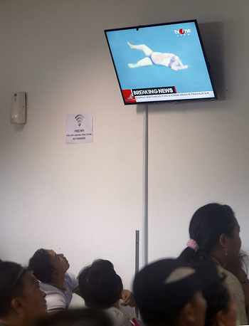 Indonesian rescuers recovered several bodies from the Java Sea, where a Malaysian passenger aircraft was discovered