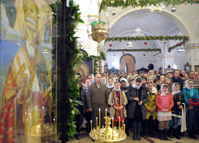 Russian President Vladimir Putin attends a Christmas Eve service at the church in the village of Otradnoye, Voronezh Region, Russia
