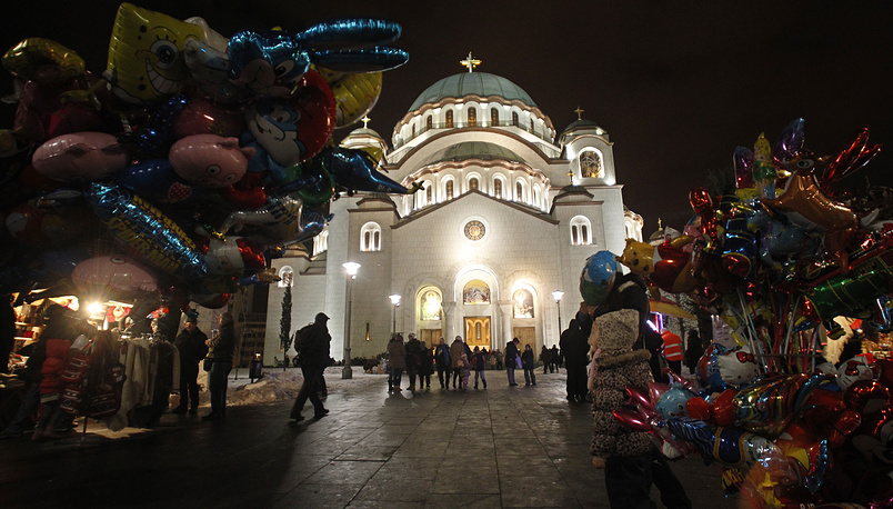 People arrive for the Orthodox Christmas Eve, in front of St. Sava church in Belgrade, Serbia