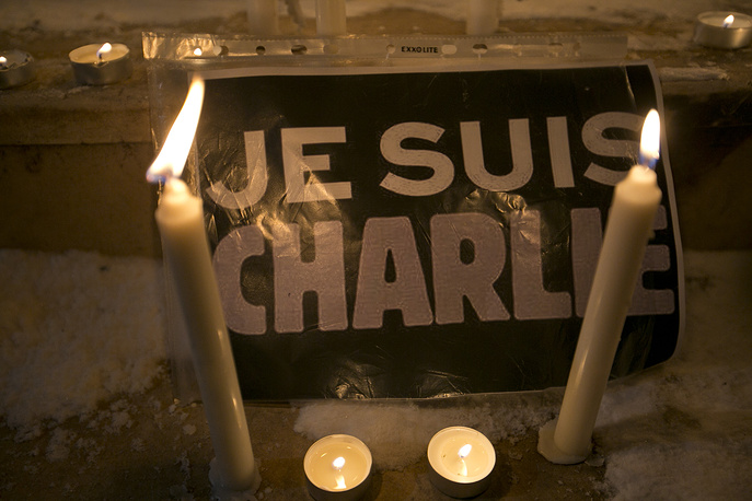 """Candles are lit near a sign that read in French """"I am Charlie"""" in Kosovo capital Pristina"""