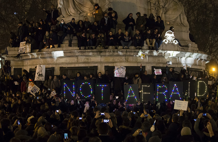 Thousands of people gather for a candle light vigil on Place de la Republique in central Paris after the attack by two gunmen on the 'Charly Hebdo' headquarters in Paris, France
