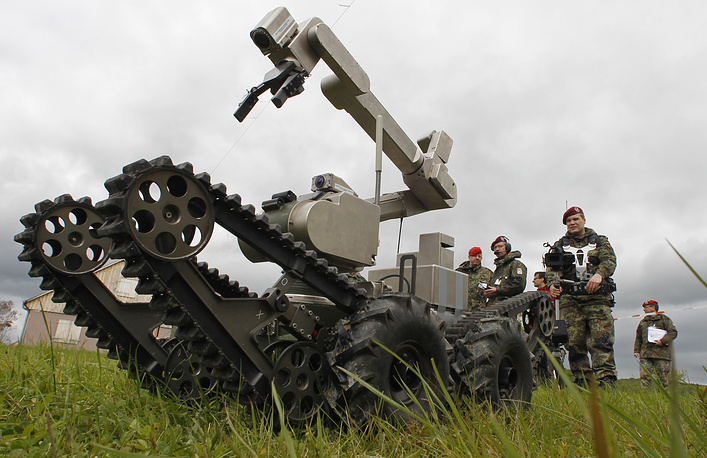 Soldiers film the robot vehicle teleMAX of the German company Telerob during the European Land Robot Trial show in Hammelburg, southern Germany