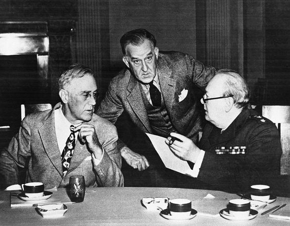 US President Franklin D. Roosevelt, British Prime Minister Winston Churchill during luncheon at the Livadia Palace in Crimea on February 18, 1945. Roosevelt's Secretary, Stephen Early, stands in back of the two Allied leaders