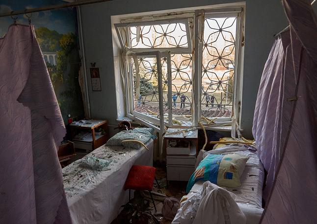 Photo: Shattered glass in the damaged hospital N 27 in Donetsk in the aftermath of a shelling attack