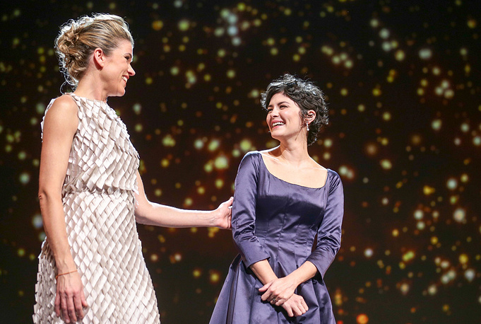 Host Anke Engelke and Berlinale jury member Audrey Tautou on stage in Berlinale Palace