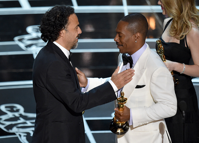 """Birdman"" won the Oscar for the best original screenplay. Photo: Eddie Murphy, right, presents Alejandro G. Inarritu with the award"
