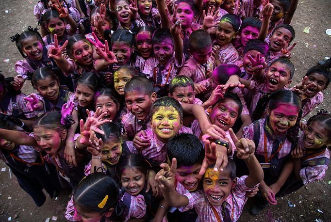 Indian school children during the Holi festival celebrations at the Raja Shivaji school in Ghodbander village near Mumbai, India