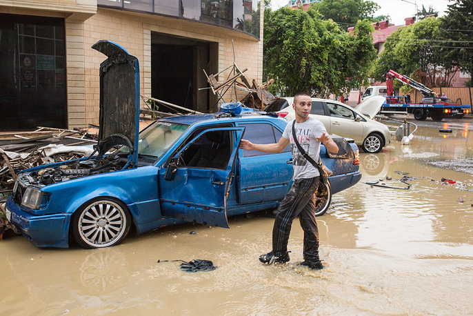 The flooding caused by torrential rains brought the resort city of Sochi to a standstill
