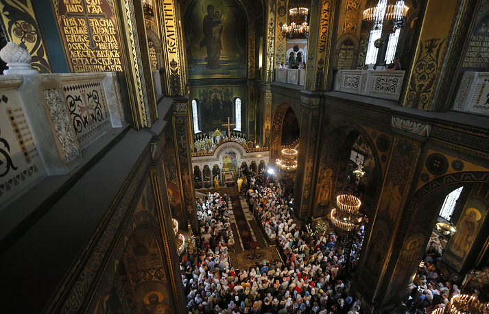 Believers at religious service marking the the 1000th anniversary of the death of Great Prince Vladimir in the St. Volodymyr Cathedral in Kiev, Ukraine