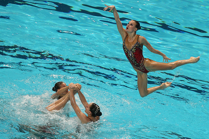Members of the Russian team competing to win the synchronised swimming free combination final, August 1