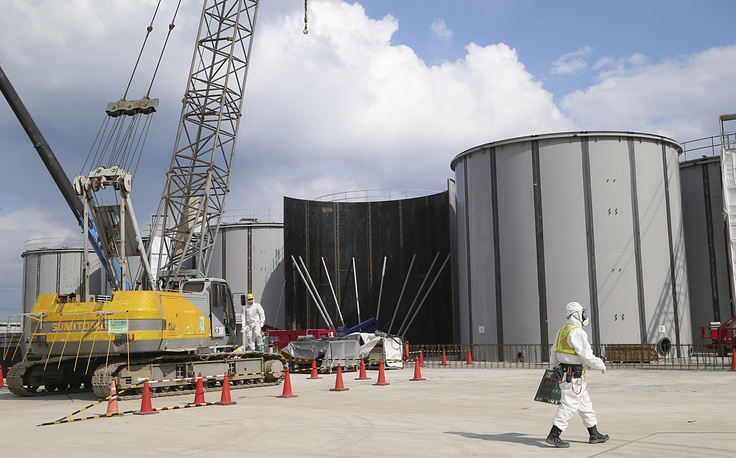 The reopening of the 1.78GW nuclear power station will be an important benchmark in Japan's energy policy. Photo: Workers building tanks to store radioactive water in the compound of the Fukushima Dai-ichi nuclear power plant in Okuma t, 2014