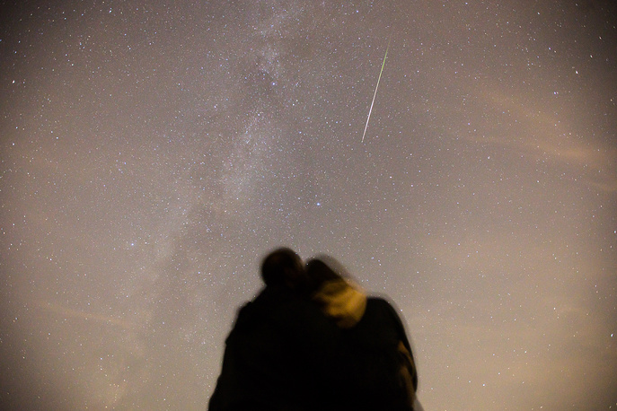 Couple watching Perseid meteor shower in Kazan, Russia