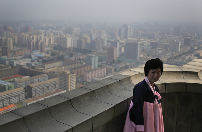 The second tallest building in Pyongyang is the Tower of the Juche Idea. Inside the 170-meters obelisk, there's a lift to a viewing point on the top. Photo: tour guide standing on the top of the Tower of Juche Idea
