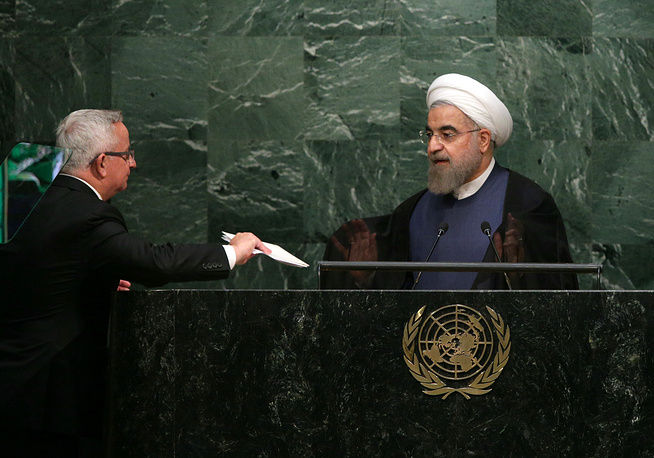President of the Islamic Republic of Iran Hassan Rouhani (right)