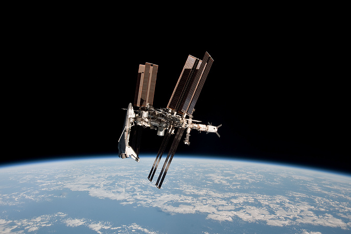 ISS and the docked space shuttle Endeavour, taken from the Soyuz TMA-20 following its undocking on May 23, 2011