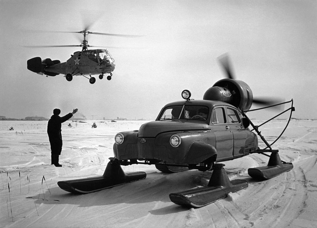 Arctic transport vehicles. Aerosani, a type of propeller-driven snowmobile, and a helicopter, 1959