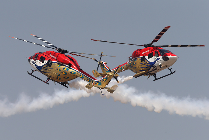 Helicopter aerobatic team of the Indian Air Force 'Sarang display their skills during at Aero India 2015, February 18, 2015