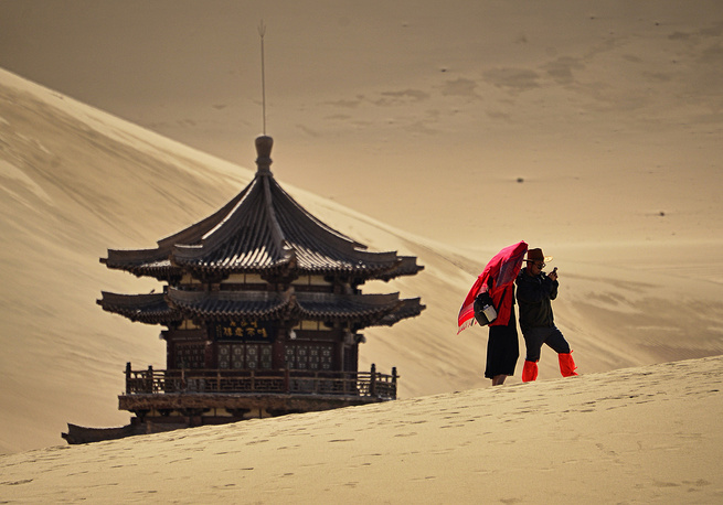Tourists seen in the oasis in the Taklamakan Desert, China, July 21, 2015